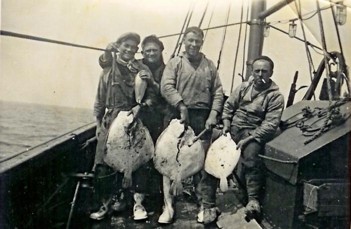Vissers met platvissen
