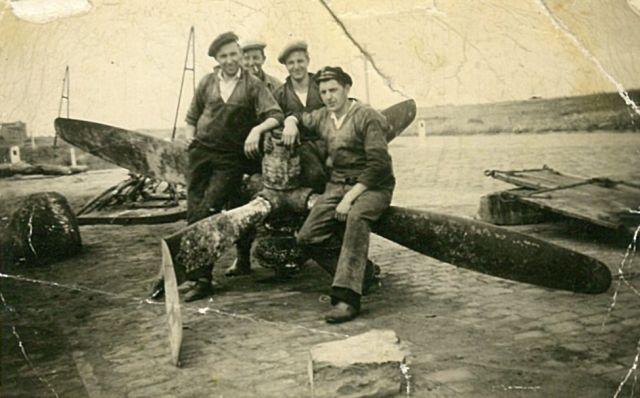 Vissers bij een schroef