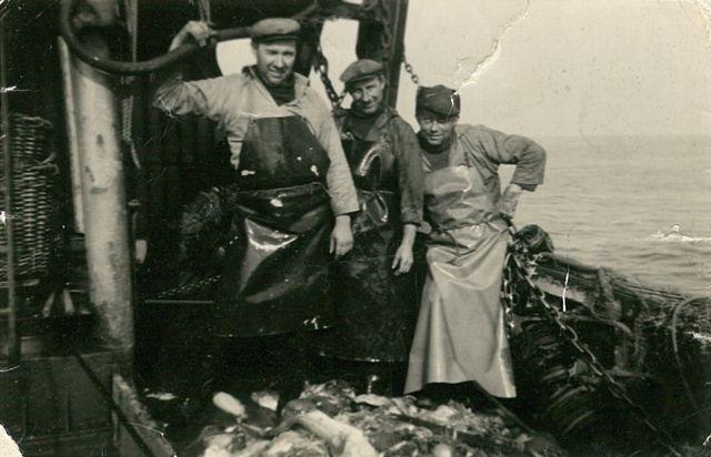 Vissers kuisen vangst aan boord