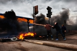 Boulogne-sur-Mer, France.  Striking fisherman, protesting about the low price of fish, block the main road artery in the port's fish processing district, Capécure, with burning tyres