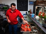 Calum Greenhalgh and steamed lobsters in his shop and cafe 'Fresh from the Sea', which he runs with his wife Tracey. Port Isaac, North Cornwall.