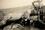 Visser aan boord van de N.738