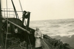 Maurice Dobbelaere met olierok en zuidwester op de Z.511 Normandië (Bouwjaar 1955), author: Onbekend