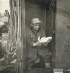 Charles Dekoninck aan boord van de Z.562, author: Onbekend