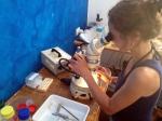 Marine biologist Katja Guilini working at a binocular in a lab on Panarea, studying ocean acidification
