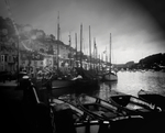 The first picture was taken in spring 2012, just before astorm hit. It shows the ratio of pleasure craft to fishingboats in Looe harbour.  Looe exhibition, England.