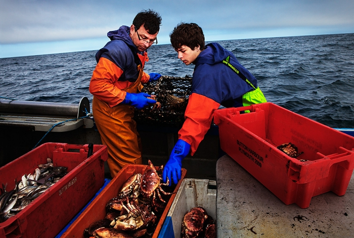 Calum Greenhalgh and his son Jack working aboard their boat 'Mary D'.  Calum and his wife Tracey own and run the 'Fresh from the Sea' Fish Shop in Port Isaac, north Cornwall
