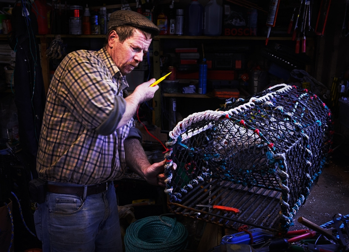 Nicky King, fisherman, Wells-next-the-Sea, north Norfolk, constructing crab pots in his shed