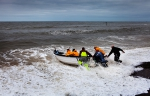 Fishermen launching their boat in Sheringham, north Norfolk, March 2013